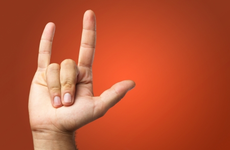 yo: Gesturing Human Hand isolated on a red background