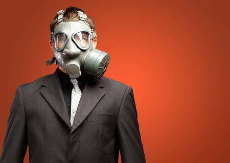 Businessman With Gas Mask against a red background Stock Photo - 17579794