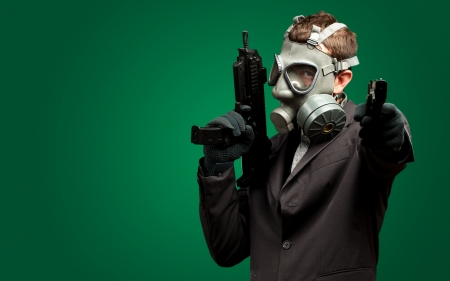Businessman Holding Gun With Gas Mask against a dark green background Stock Photo - 17692412