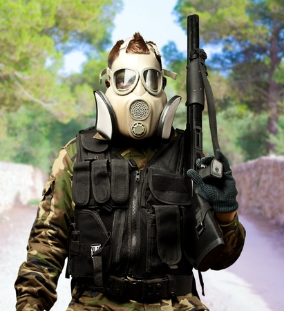 Portrait Of A Soldier With Gas Mask at a park photo