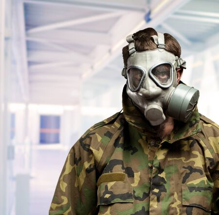 Soldier With Gas Mask in a building photo