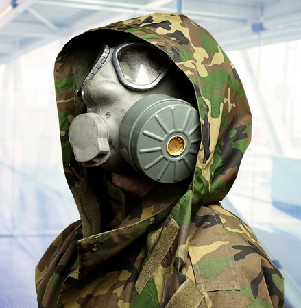 closeup of a soldier wearing a gas mask, indoor photo