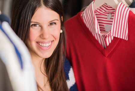 Portrait Of Young Woman Buying Shirt, Indoors  photo