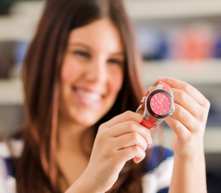 Happy Woman Buying New Wristwatch, Indoors  photo