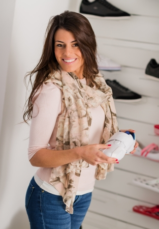 Young Beautiful Woman Buying Shoes, Indoors  photo