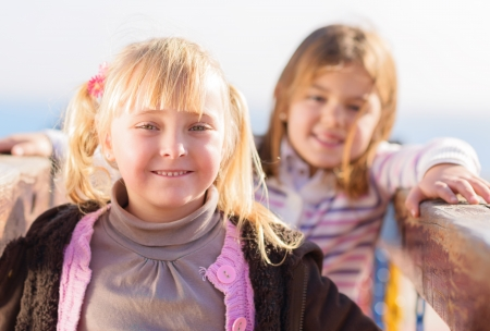 Portrait Of Two Happy Girls, Outdoors  photo