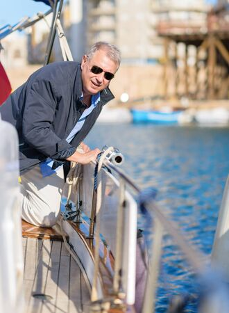 Portrait Of Mature Man On Sailboat, Outdoors  photo