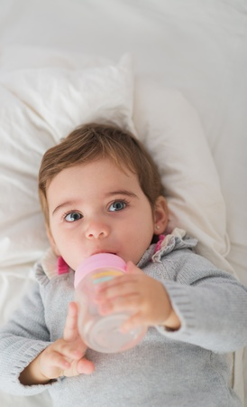 Cute Baby Drinking Water, Indoors  photo