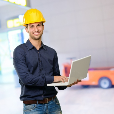 Happy Architect Holding Laptop, Indoors photo