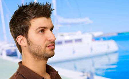 Portrait Of  Handsome Young Man, Outdoors photo