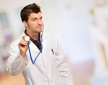 health check: Young Male Doctor Doing Check Up, Indoors