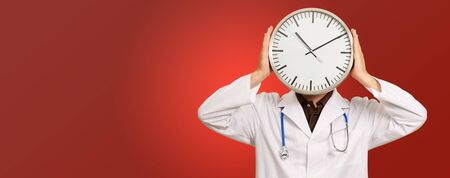 Portrait Of Doctor Hiding Face With Clock Isolated On Red Background Stock Photo - 18827851
