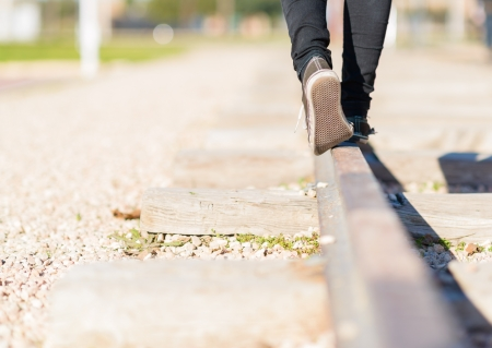 wood railroad: Woman Walking In Equilibrium Over Railroad