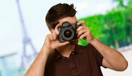capturing: Portrait Of Young Man Capturing Photo, Outdoors