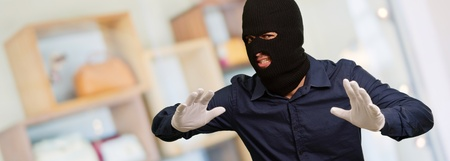 Burglar In Face Mask Isolated, Indoor Stock Photo - 18828023