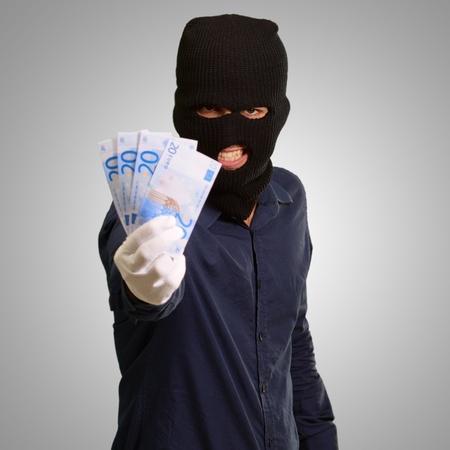 handglove: Burglar In Face Mask On Gray Background