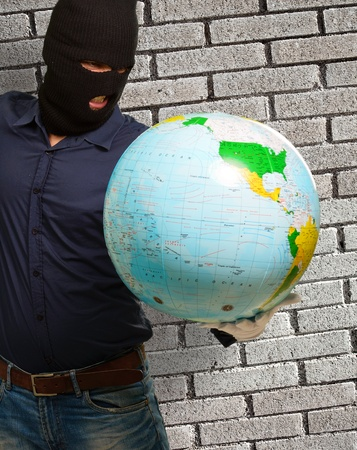 Burglar Man Holding Globe Stock Photo - 18835130