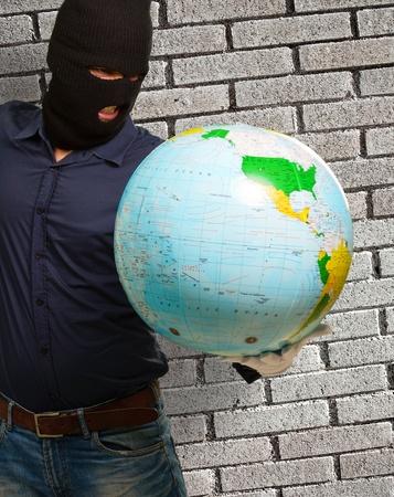 Burglar Man Holding Globe Stock Photo - 18835130