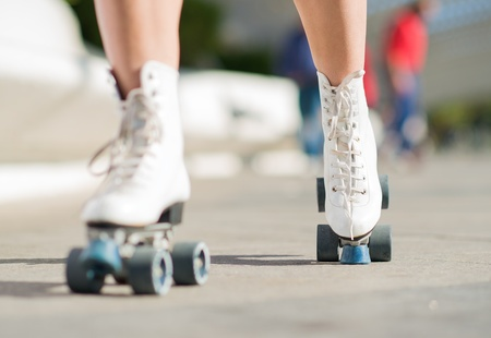 Close-up Of Womans Legs With Roller Skates, Outdoors  photo
