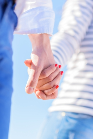 Close-up Of Couple Holding Hand, Outdoors  photo