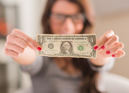 one dollar bill: Happy Woman Holding American Dollar Currency, Indoors