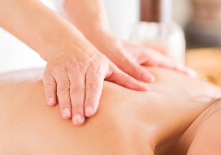 body massage: Attractive Woman Having A Massage With Massage Oil In A Spa