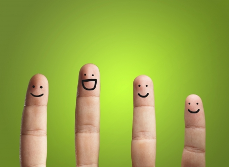 Close-up Of Fingers With Smiley Face Isolated On Green Background Standard-Bild