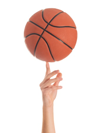 fingers on top: Close-up Of Hand Spinning Basket Ball On White Background