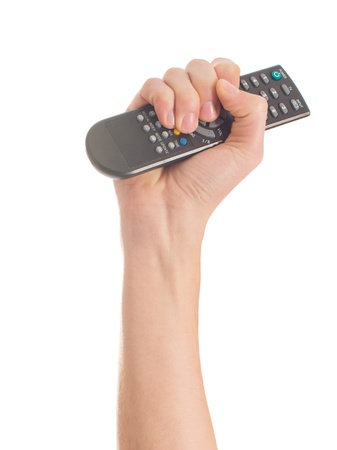 Close-up Of Human Hand Holding Remote Control On White Background