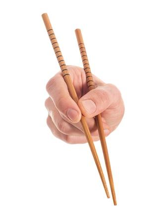 Close-up Of Hand Holding Chopsticks On White Background
