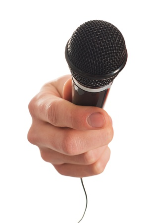 press conference: Close-up Of Hand Holding Microphone On White Background