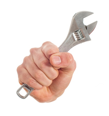 Close-up Of Hand Holding Wrench On White Background photo