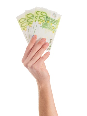 Close-up Of Hands Holding Euro Note On White Backgrounds photo