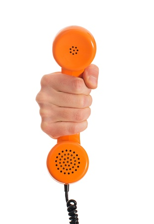 Close-up Hand Holding Telephone Receiver On White Background photo