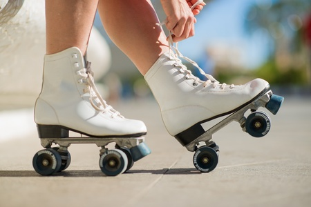 Close-up Of Legs Wearing Roller Skating Shoe, Outdoors photo