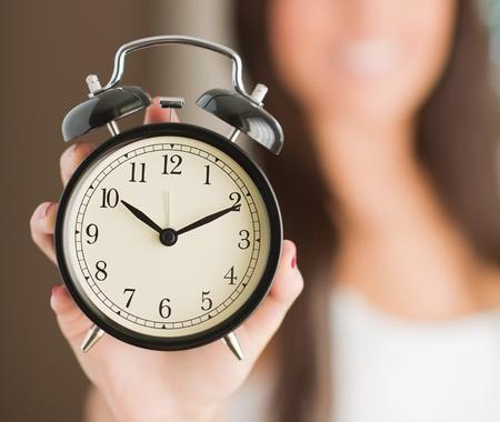 Woman Holding Clock, Indoors photo