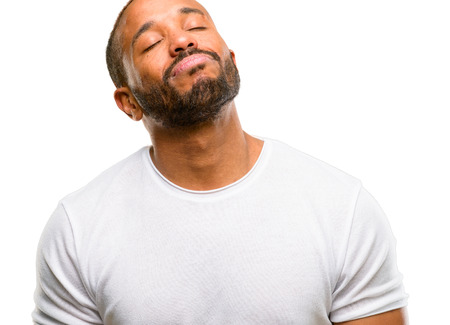 African american man with beard with sleepy expression, being overworked and tired isolated over white background Stock Photo