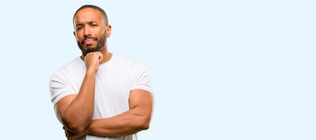 African american man with beard thinking thoughtful with smart face isolated over blue background