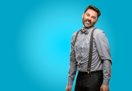 Middle age man, with beard and bow tie angry and stressful frowns face in dissatisfaction, irritated and annoyed, expressing anger Stock Photo