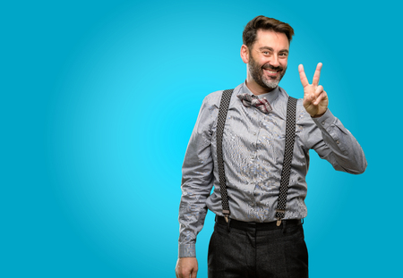Middle age man, with beard and bow tie raising fingers, number two Stock Photo