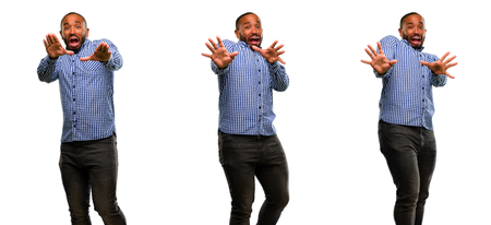 African american man with beard disgusted and angry, keeping hands in stop gesture, as a defense, shouting Stock Photo