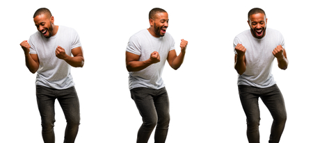 African american man with beard happy and excited celebrating victory expressing big success, power, energy and positive emotions. Celebrates new job joyful Archivio Fotografico