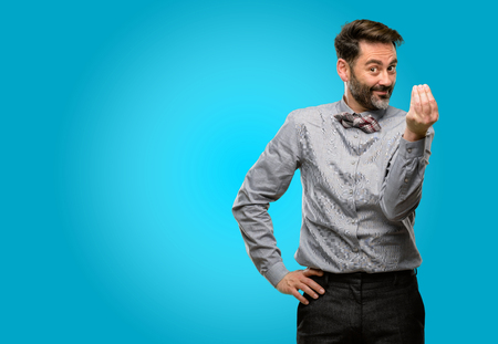 Middle age man, with beard and bow tie angry gesturing typical italian gesture with hand, looking to camera Stock Photo