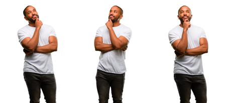 African american man with beard thinking and looking up expressing doubt and wonder