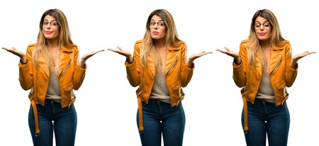 Beautiful young woman doubt expression, confuse and wonder concept, uncertain future over white background Stock Photo