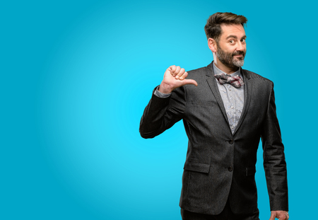 Middle age man, with beard and bow tie proud, excited and arrogant, pointing with victory face