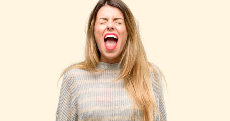 Young beautiful woman stressful, terrified in panic, shouting exasperated and frustrated. Unpleasant gesture. Annoying work drives me crazy Stockfoto