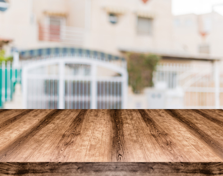 Wooden empty table board in front of blurred background. Can be used for display or montage any product. Mock up for display your product.