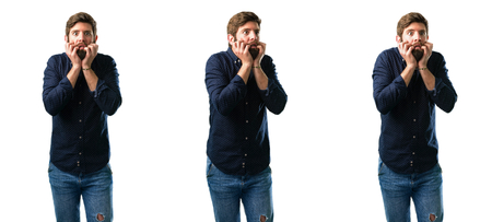 Young man with beard terrified and nervous expressing anxiety and panic gesture, overwhelmed isolated over white background