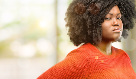 Beautiful african woman irritated and angry expressing negative emotion, annoyed with someone, outdoor Stock Photo